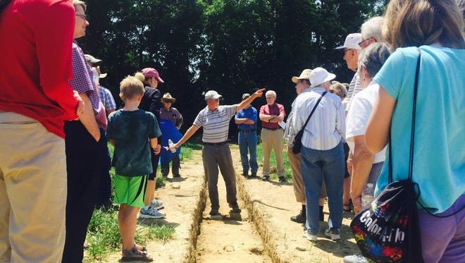 Senior archaeologist Steve Warfel explains to visitors about the dig that was done this summer in an effort to find the footprint of the Revolutionary War prison camp.