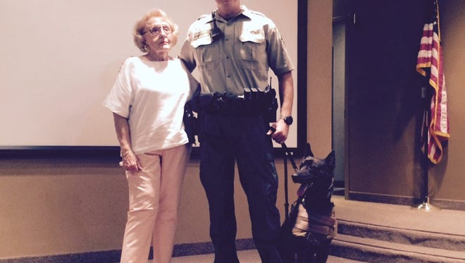 Indian Wells resident Dona Peri, left, recently donated a ballistics vest for police dog Grady to wear. Grady and K-9 Officer Matthew Allert serve with the SWAT team.