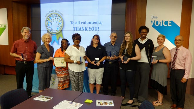 Pictured left to right: Jerry Gillette, Board Member of the Year; Charlotte Jones, Delores Alexander and Jeannette Holley Broadway, Foster Grandparent Program, Volunteer Group of the Year; Bonnie Parr, Volunteer of the Year; George Wentz, Continuing Service Award; Reanne Beattie, Youth Volunteer of the Year; Takia Nelson, Laura Zalle and Linh Nguyan, Riverwalk Centre Bigs In Business.