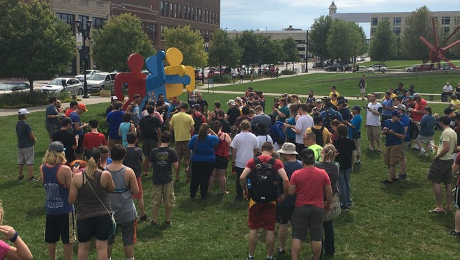 """Hundreds of """"Pokemon Go"""" players gather in the Pappajohn Sculpture Park for Sunday's meetup."""