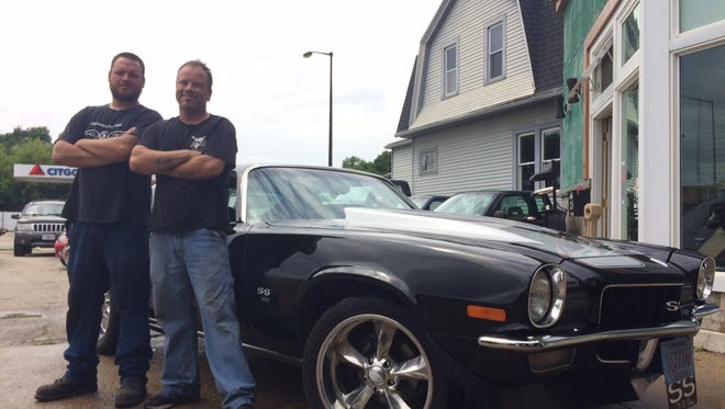 Darryn Shipton and Christian Newby at My Custom Shop with a Newby's newly polished 1970 L78 Camaro. Newby recently joined the custom auto shop from Waupaca.