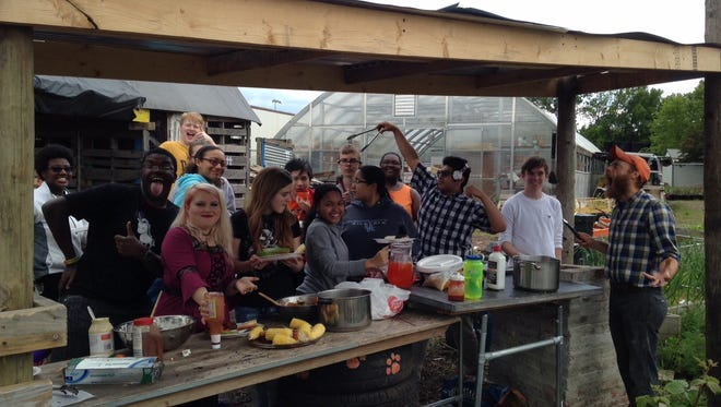 Cooking Club celebrates the end of the year with a cookout using the school's outdoor kitchen and brick oven.