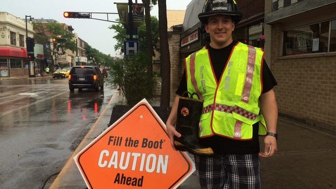 Despite a drizzle Thursday, firefighter Nate Philipsky helped raise funds for muscular dystrophy, along with Fond du Lac's Firefighter's union members.