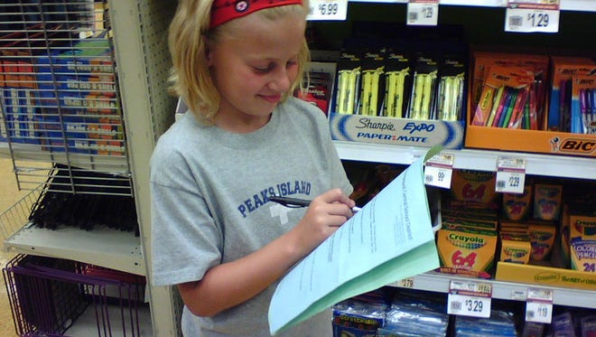 Alyssa Memmott (granddaughter of Jim Memmott) checking off her school-supply items as she and her grandfather went shopping for supplies back in 2007.