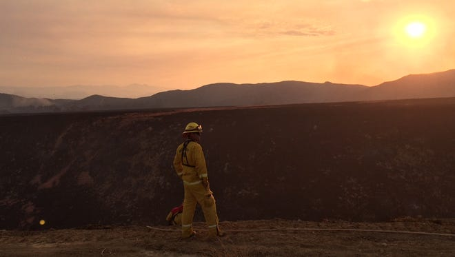 Firefighters battle the Bogart Fire in Cherry Valley on Tuesday, August 30.
