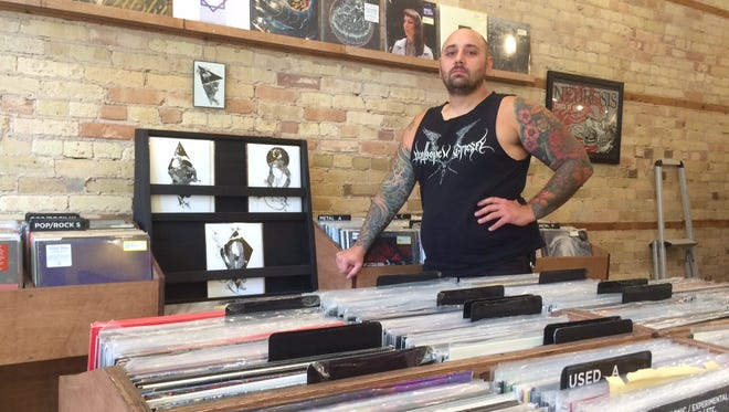 Adam Bartlett, owner of Eroding Winds, 605 S. Main St., a new record shop specializing in hard-to-find heavy music.