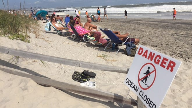 People sit at the beach  in Ocean City on Sept. 4 as Hermine kept would-be swimmers out of the water.
