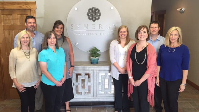 Paige Tuck and Ann Koetting, founders of Synergy Recovery Center in Rogersville, have opened a new counseling center in Springfield. Pictured from left are Ann Koetting (clinical director), David Simmons (group facilitator), Kimberly Sallee (receptionist), Kristal McCleary (counselor), Julie Wrocklage (counselor), Melissa Sundwall (group facilitator), Mark Koetting (psychologist) and Paige Tuck (executive director).