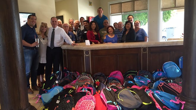 Indio's Sunrise Rotary Club collected 210 backpacks for Indio kids in need.