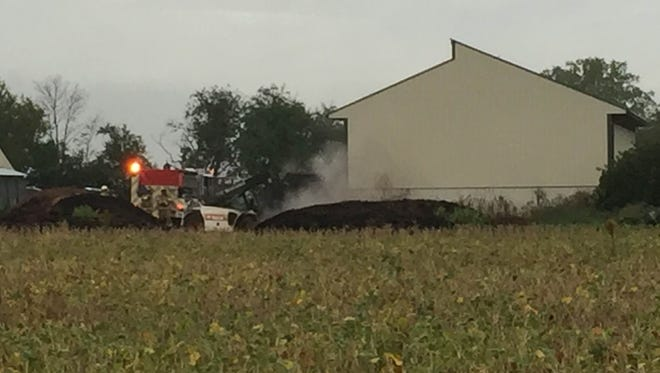 Fire companies are on the scene at 2717 Tunnel Hill Road in North Lebanon Township Monday morning for what appears to be a smoking mulch fire. A small earth mover removes piles of dirt from an open barn. Trace amounts of smoke continue to vent from the back of the barn as the earth mover pulls the mulch from the barn and pulls it away from the structure. Crews were dispatched to around 7:15 a.m.