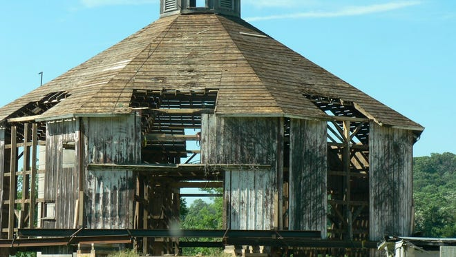 The round barn early  this summer after years of deterioration and before reroofing.