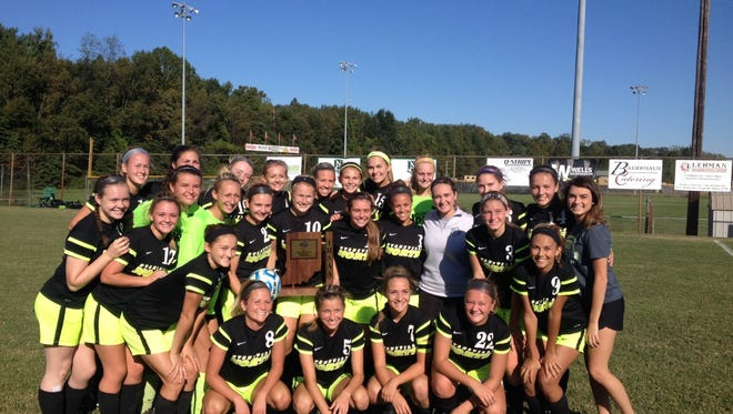 The North girls soccer team poses with the sectional trophy after defeating Reitz.