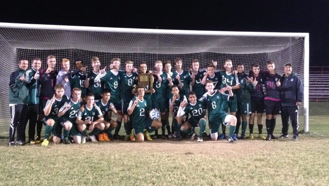 The North boys soccer team celebrates after winning the Sectional 32 title over Mt. Vernon.