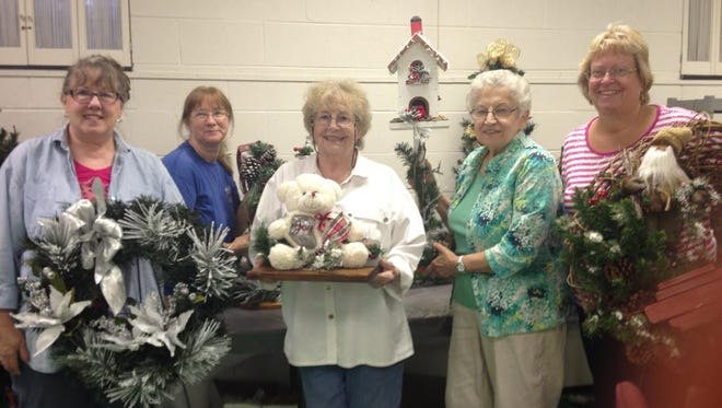 Showing off some items from the upcoming Silver Bells Market are (fromm left) Pat Cantrell, Ann Stacho, Bev Wensko. Joan Watson and Mary Carney.