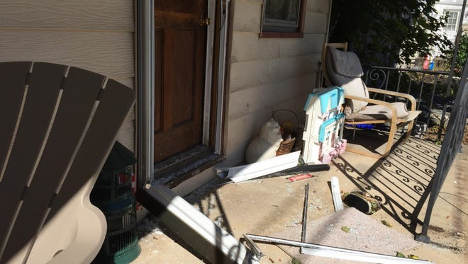 A front door of a home in the 100 block of South Main Street, Mount Wolf, was damaged during a standoff there Sunday night.
