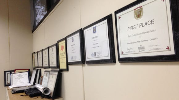 York Daily Record community engagement editor Scott Fisher has already run out of space on his office wall to display awards he has won over the past decade. He'll soon have two more: a first place in the Opinion Page category in Pennsylvania Newspaper of the Year competition and a first place in the William A. Schnader Award competition for his work in legal journalism. The Pennsylvania Bar Association sponsors that award.