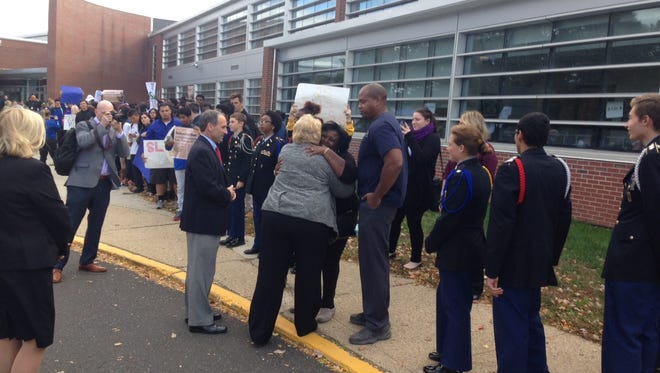 """Former State Sen. Diane Allen hugs Jolene Covington, the grandmother of former Burlington City student Antwan Timbers Jr., who was killed after being hit by a drunk driver on Route 130 in May of 2016. The school started a campaign called '25 Saves Lives' calling for full-day reduction in the speed limit in the school zone along Route 130. Allen signed three bills several years ago regarding controlling speed limits in school zones, one she named """"Antwan's Law."""""""