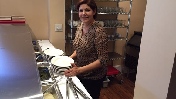 Nelo Mayar, chef and owner of Aryana Restaurant, prepares to serve a hungry crowd at the preview event Saturday, Oct. 29.