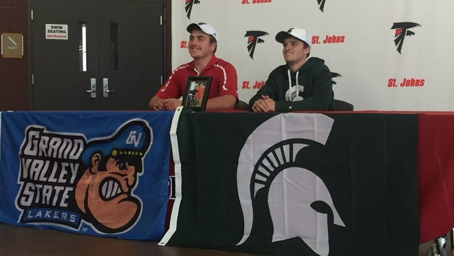 St. Johns senior golfers Eric Nunn (left) and Zach Rosendale (right) signed their National Letters of Intent Wednesday at St. Johns High School. Nunn will attend Grand Valley State and Rosendale will be going to Michigan State.