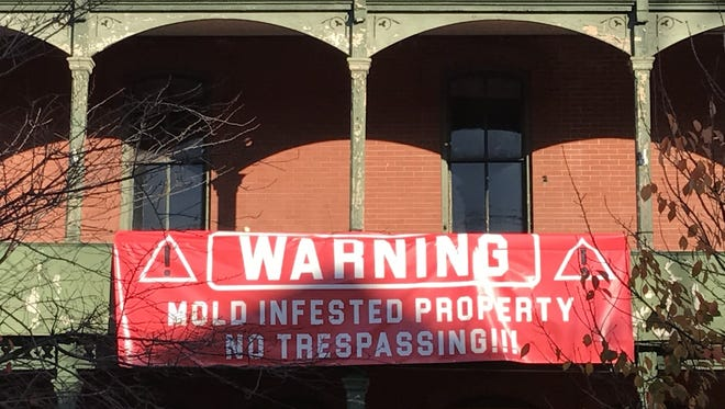 Nobody knows who hung this banner on the front of the Union Hotel in Flemington a day before a rally to save the Main Street building from demolition.