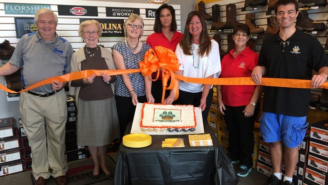 Shown from left are Al Goldsmith, Margaret Ayers and Bonnie Bardey from the Lavonia Chamber of Commerce; Guard Your Dogs Safety Shoes Inc. co-owner Synicia Williams; chamber vice president Janet Appling; co-owner Lori Kajano; and employee Brett Williams.