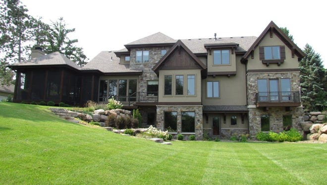 The nearly one-acre lot has been professionally landscaped.