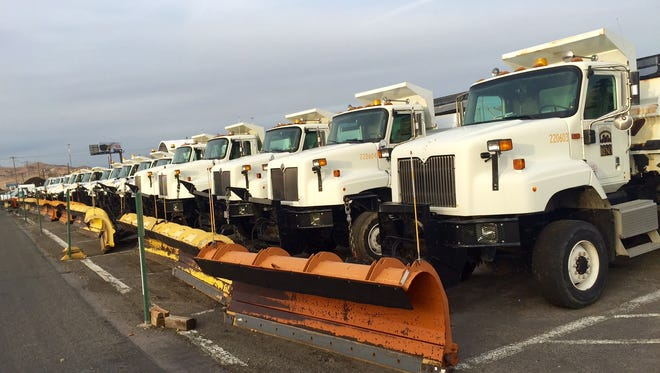 A fleet of plow trucks line a parking lot at the City of Reno Public Works Department.