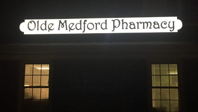 Authorities allege Olde Medford Pharmacy in Medford was a magnet for people with fraudulent or stolen prescriptions.