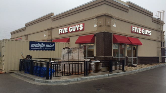 Work continues at Oshkosh's planned Five Guys location.