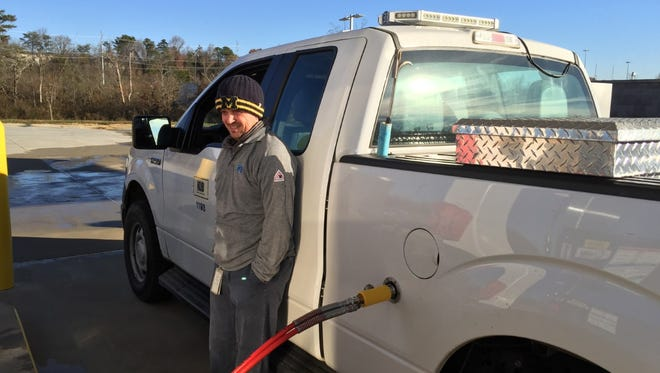 Jason McRae, a KUB meter reader, fills up at KUB's new compressed natural gas station on Middlebrook Pike.