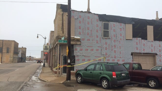 The city of Oshkosh might purchase two properties, 710 and 716 S. Main St., in an effort to redevelop that block.
