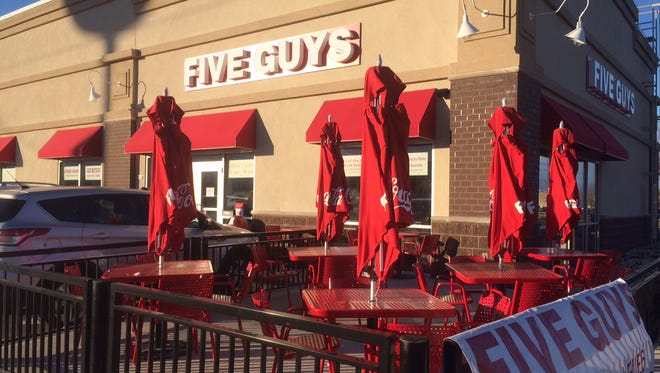 Five Guys has again delayed its opening, and may now open Dec. 12.