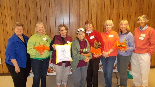 Shown from left at the Lavonia Garden Club meeting were: Velda Benifield, hostess; Ellen Waters with cactus; Judy Hulsey with pillow; Kitty Coyle with cactus, Krista Fitzgerald with cactus, Judy Brunson hostess; Susan O'Connell with cactus and Jan Taylor hostess.