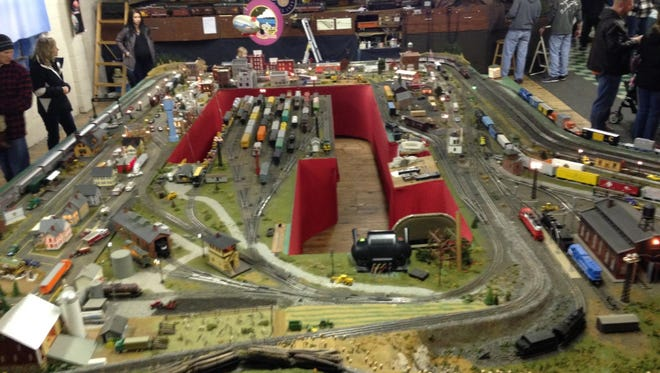 Reps from the Glen Rock Hose & Ladder Co. keep an eye on the show, at the rear of the Hufnagel Public Library of Glen Rock. The view from the control tower. Above the main model train platform is a raised area that commands all the trains of varying scales. In the 2017 show, the show has 5 layouts in N, HO, O, and G gauge. The O gauge layout that uses all ceramic buildings and Christmas Trees in new this year.