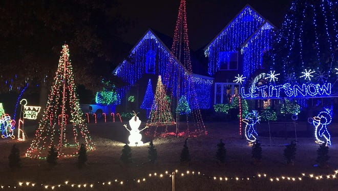 This year, Mike Willis added more lights to his flashing holiday display.