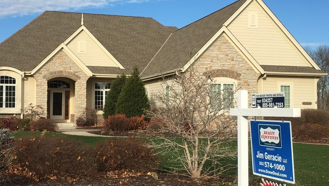 A report says pending home sales were down in November amid higher mortgage rates and tight inventory of homes for sale.