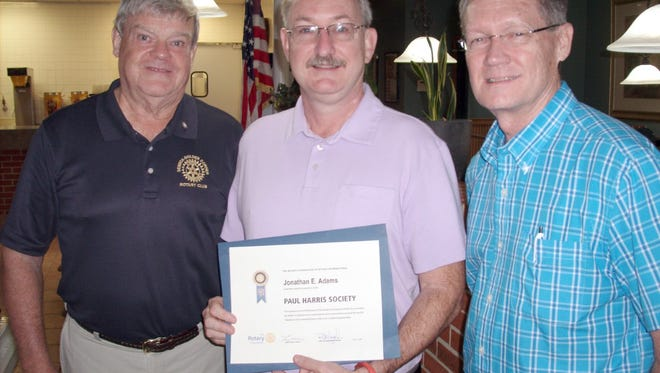 Shown from left are President Don Lesley, Jon Adams and Vic Holley.