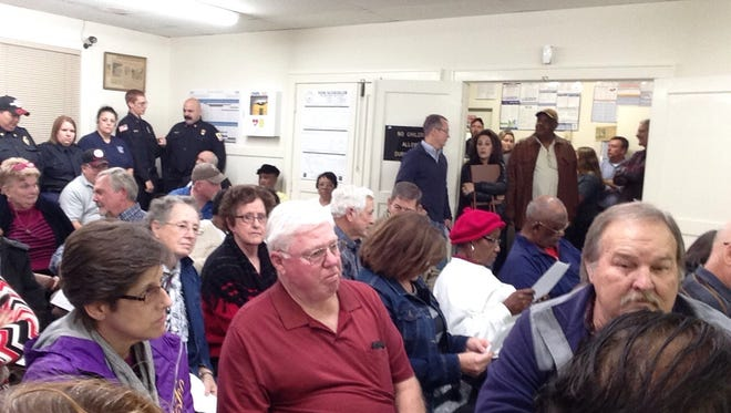 Residents pack the meeting room at Lecompte Town Hall on Monday night. Most were there to discuss an increase in the Lecompte Volunteer Fire Department's fire classification rating, which translates into higher insurance rates for residents.
