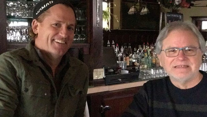 Mike Eitel (left) has bought the Cardinal Bar in Madison from Ricardo Gonzalez (right) and will rename it Nomad World Pub in March.