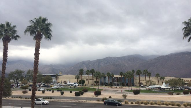 Gray clouds hover above the Coachella Valley ahead of a storm that's expected to drop small amounts of rain Thursday.