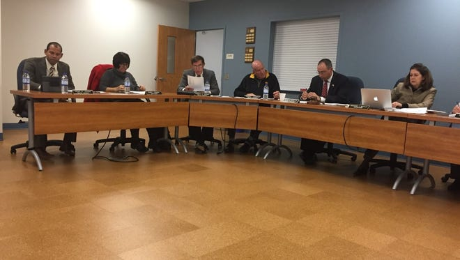 Lebanon school directors (from left) Cesar Liriano, Deb Bowman, Rob Okonak, Tom Schaffer and Peter Pyles, and Supt. Marianne Bartley listen to Rep. Frank Ryan (R-101) speak briefly about the state budget process at Monday's school board meeting.