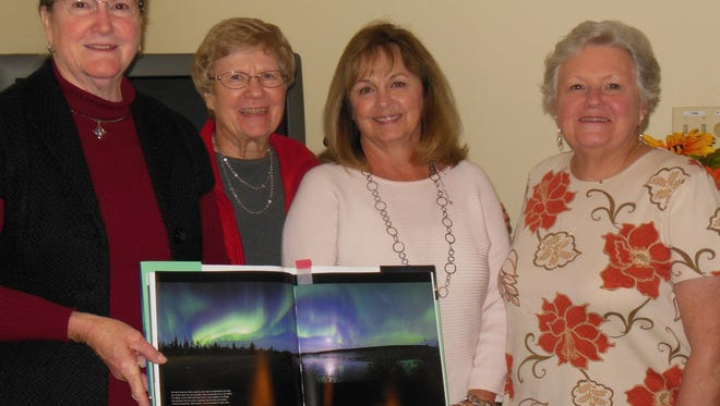 Shown from left are Jennifer Horton, speaker, with picture of the Northern Lights; and Lavonia Woman's Club members Andrea Mathis, Debbie Flowers and Genie Burks, who served as hostesses.