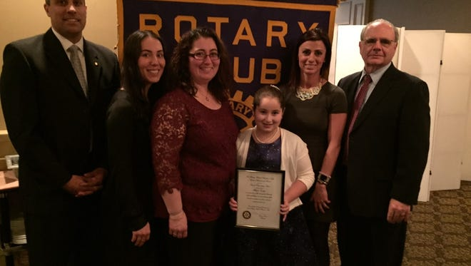 Fifth grade student Mikeyla Taskaya, named the 2017 Student Achievement Award recipient from Pompton Lakes Lincoln School, was honored by the Rotary Club of Pompton Lakes at a special luncheon in her honor by (from left) Rotarian and Pompton Lakes Superintendent of Schools Dr. Paul Amoroso, Mikeyla's aunt Huyla Kuday, her mother, Selma Taskaya, her teacher, Dana Johnston, and Lincoln School Principal Louis Shadiack.