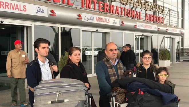Fuad Suleman, center, with his wife and three children arrive back in Erbil, Iraq, after officials at Cairo International Airport told the family they could not continue on a connecting flight to New York's JFK Airport on their way to Nashville Jan. 28, 2017. Instead, they were sent back to Iraq.