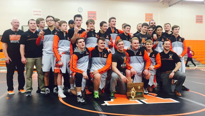 The Ashland Arrows celebrate their Division II regional championship in the state team wrestling tournament.