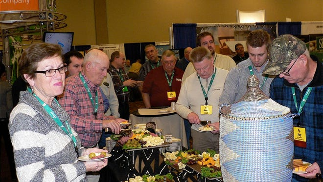 Ag conferences have lots of food, like this reception prior to the Taste of Elegance banquet  sponsored by the Pork Producers.