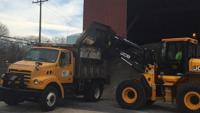 Lebanon highway department workers prepare for a snow storm that could dump as much a 8 inches on the city overnight Wednesday.