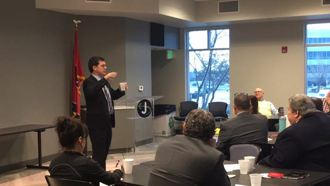 STAR Center President Dave Bratcher speaks to the audience at the Business@212° breakfast on Thursday.
