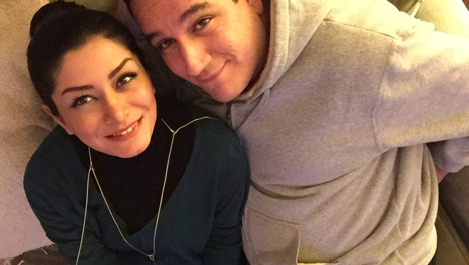 Sherry Saadati, 32, and Roozbeh Entezari, 41, of Pittsfield Township, immigrated from Iran.