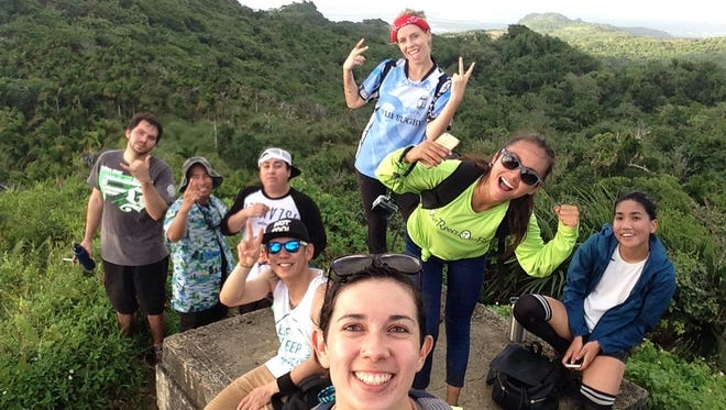 Katy Clarke and her hiking crew reach the top of Mt. Lam Lam.